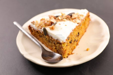 Photo for Carrot cake with cream and nuts, slice - Royalty Free Image