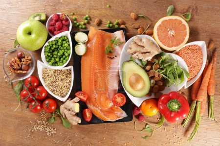 Photo for Selection of health food with salmon, fruit and vegetable - Royalty Free Image