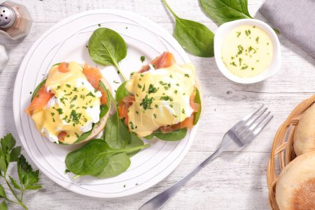 Photo for Muffin with poached egg, sauce and salmon - Royalty Free Image