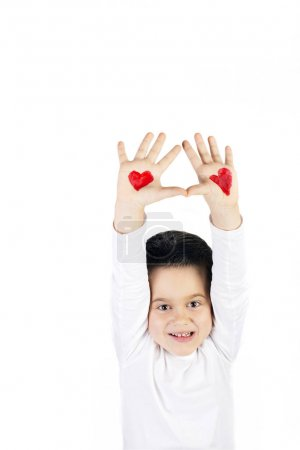 Boy with raised hands painted with hearts