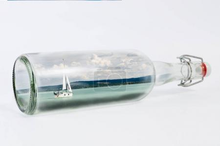 sailing boat in glass bottle