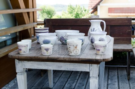old table with porcelain dishes