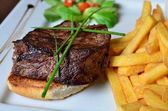 Steak with herbs and fries