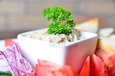 Creamy  pate in bowl  and fresh vegetables