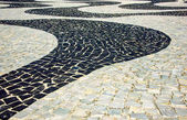 Black and white iconic mosaic by old design pattern at Copacabana Beach, Rio de Janeiro, Brazil