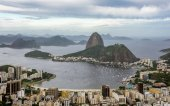 Aerial view of Sugarloaf mountain, boats floating in Botafogo Bay and cityscape, Rio de Janeiro