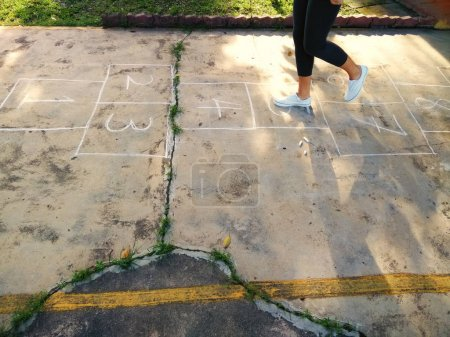 Photo for Hopscotch game for children to play drawn out on the concrete sidewalk - Royalty Free Image