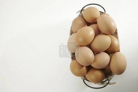 Basket with chicken eggs