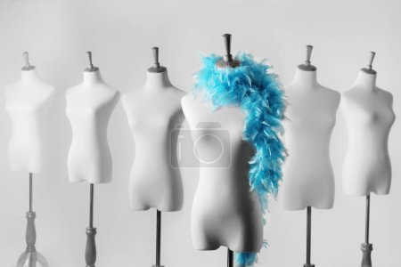 female mannequins with feathers