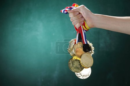 hand holding medals