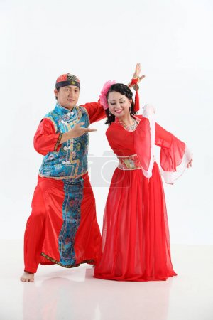 Chinese couple with traditional costumes posing in studio
