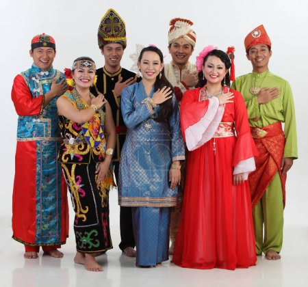 Malaysian people in traditional clothes posing in studio