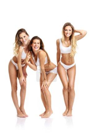 Happy friends posing in underwear