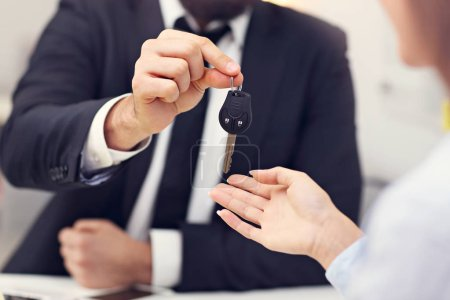 businesspeople with car key