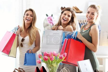 happy friends shopping in store
