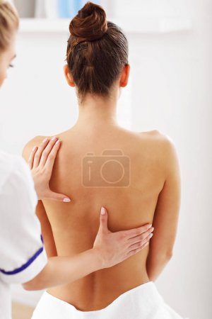 woman having back therapy