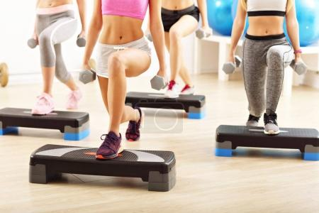 Photo for Group of happy women doing aerobics - Royalty Free Image