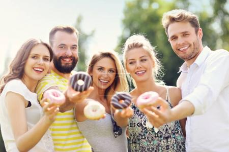 Group of friends eating donuts