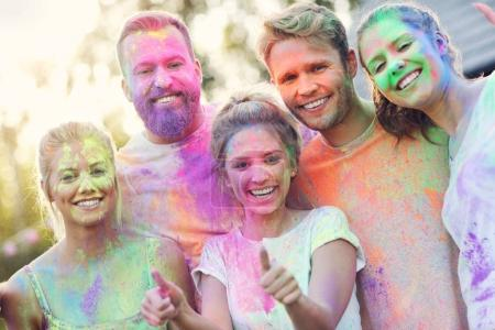 Photo for Picture showing group of friends having fun at color festival - Royalty Free Image