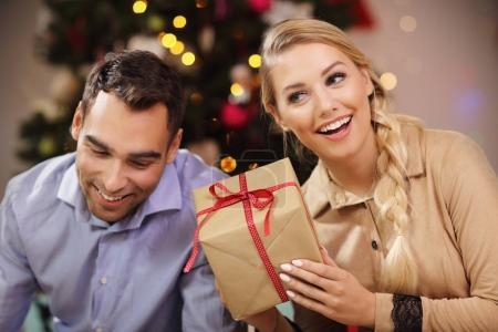 Happy Couple Opening Christmas Present