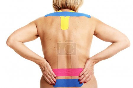 Picture showing special physio tape put on injured back over white background
