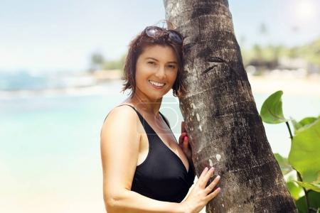 Picture showing happy woman relaxing on the beach in summer