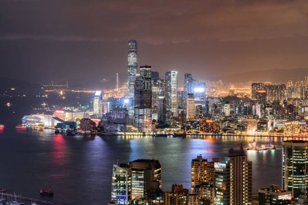 Photo for Colorful night aerial view of Victoria Harbor and Hong Kong. Awesome cityscape. Hong Kong is a popular tourist destination of Asia. - Royalty Free Image