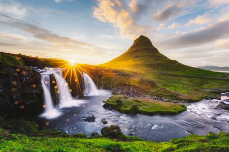 Photo for Morning landscape with rising sun on Kirkjufellsfoss waterfall and Kirkjufell mountain, Iceland, Europe. Landscape photography - Royalty Free Image