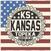Decorative stamp with text United States of America KS KansasTopeka January 29 1861 on USA flag