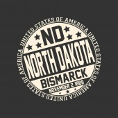 Decorative stamp on black background with postal abbreviation ND state name North Dakota capital Bismarck and date become a state November 2 1889 with text United States of America around it