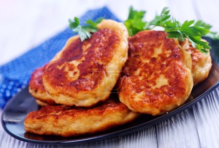 cutlets on black plate