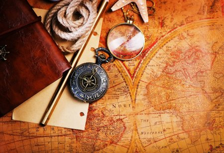 old notebook, loupe and compass