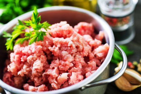 Photo for Minced meat in bowl and on table - Royalty Free Image