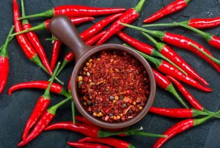 Photo for Chilli peppers on the black table, chilli background - Royalty Free Image