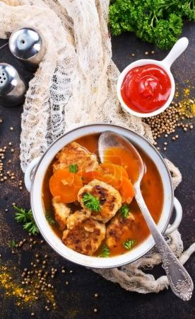 cutlets with tomato sauce in white pot