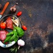 Smoked sausage with spices and fresh basil in plat...