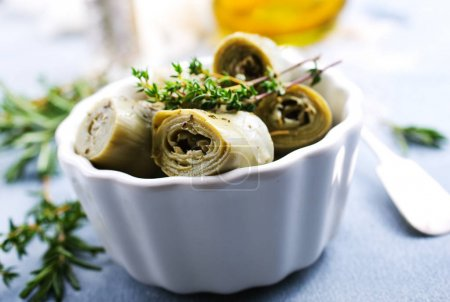 close-up view of artichoke hearts in white bowl on table