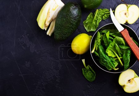 Photo for Composition of green vegetables and fruits  on dark table - Royalty Free Image