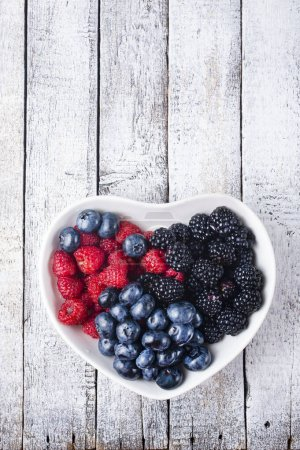 Photo for Fresh mox berries in white bowl on  a table - Royalty Free Image