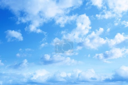 Photo for Fluffy clouds in a blue sky - Royalty Free Image