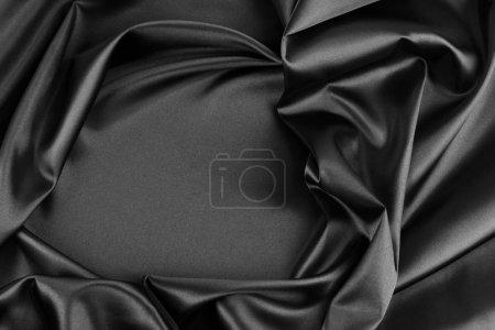 Photo pour Fermeture du tissu de soie noir ondulé - image libre de droit