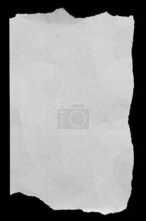 Torn paper on black