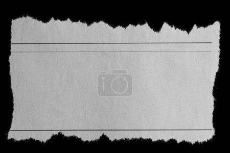 Foto de Pedazo de papel rasgado en negro - Imagen libre de derechos