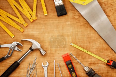 Assorted tools on wood