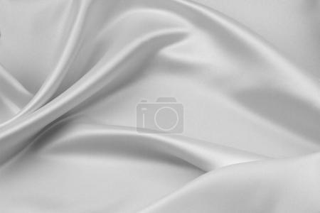 Photo pour Gros plan de tissu de soie blanc ondulé - image libre de droit