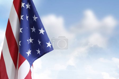 Photo for American flag in front of blue sky - Royalty Free Image