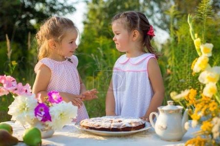 cute girls having picnic
