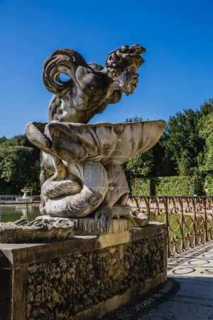Sculpture of harpy and pond in Wonderful Boboli Ga...