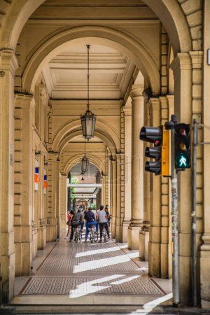 Historical architecture and people on the street of Bologna city, Italy