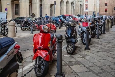 Historical architecture and bikes on the street of Bologna city, Italy
